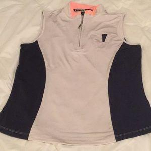 Jamie Sadock navy and tan sleeveless golf shirt.